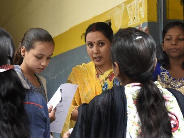 Parents of schoolchildren and teachers interact with in a Sonia Vihar school.