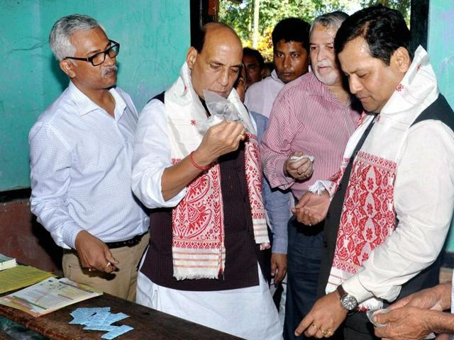 Assam CM Sarbananda Sonowal along with Union ministers Rajnath Singh and Jitendra Singh at a relief camp in Morigaon, Assam, on Saturday, July 30, 2016.