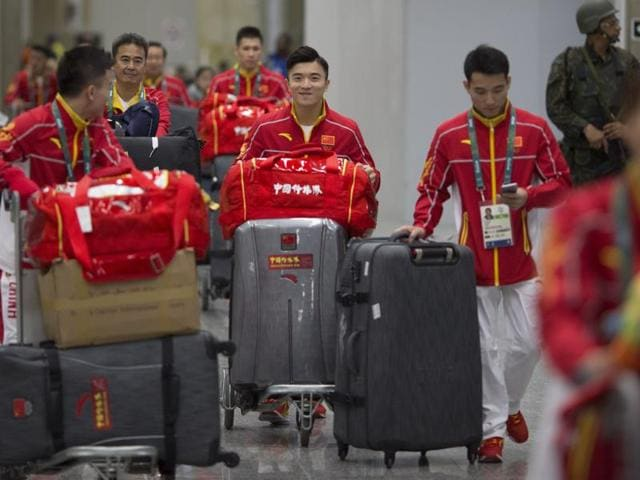 China's team arrives at Rio de Janeiro International Airport to compete at the 2016 Summer Olympics.