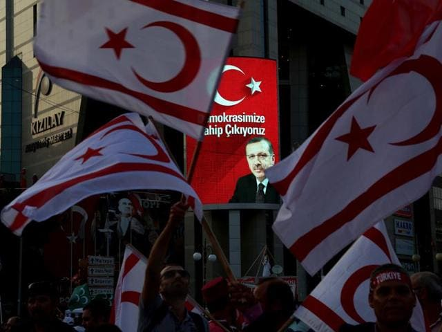 Supporters of the Republican People's Party, or CHP, stand under Turkish flags, one bearing a portrait of Mustafa Kemal Ataturk, the founder of modern Turkey, during a 'Republic and Democracy Rally' at Taksim square in central Istanbul.