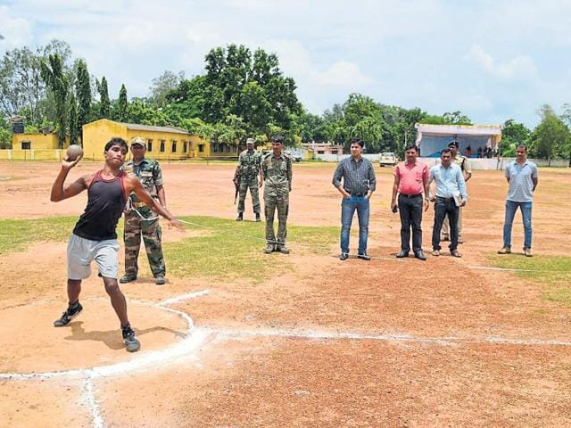 A participant throws a shot put during the district-wise police recruitment process of local tribal youth in Bastar.