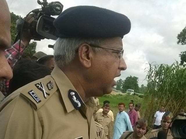 UP director general of police Javeed Ahmad visits scene of crime on Sunday.