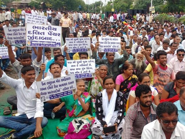 Dalit people from across Gujarat attend an Ahmedabad  rally to protest against the attack on Dalit men in Una, on Friday.