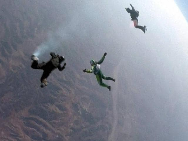 In this video screengrab provided by Mondelez International, Luke Aikins, left, prepares to go skydiving without a parachute over Simi Valley, California on Saturday.