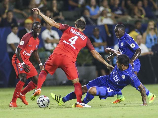 Paris St Germain's Edinson Cavani celebrates scoring a goal with his teammates.