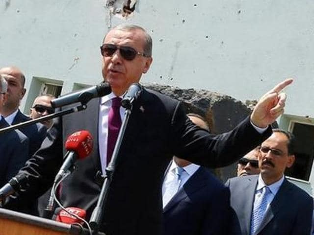 Turkey's President Tayyip Erdogan addresses the audience on Friday as he visits the Turkish police special forces base damaged by fighting during a coup attempt in Ankara.