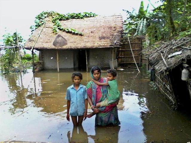 Katihar: A woman with her children at a flood-hit village in Katihar district of Bihar on Sunday. PTI Photo (PTI7_31_2016_000089A)