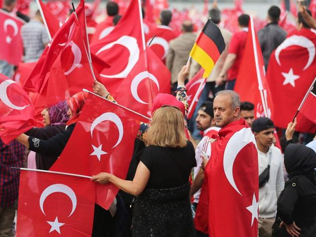 Supporters of Turkish President Recep Tayyip Erdogan attend a rally.