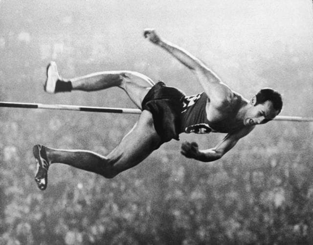 Valery Brumel clears the bar at 2m18 in the High Jump event during the Olympic Games in Tokyo.