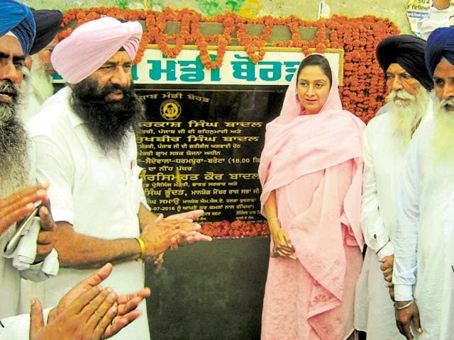 Union food processing minister Harsimrat Kaur Badal laying the foundatioin stone of a road-construction project at Budhlada in Mansa on Saturday.