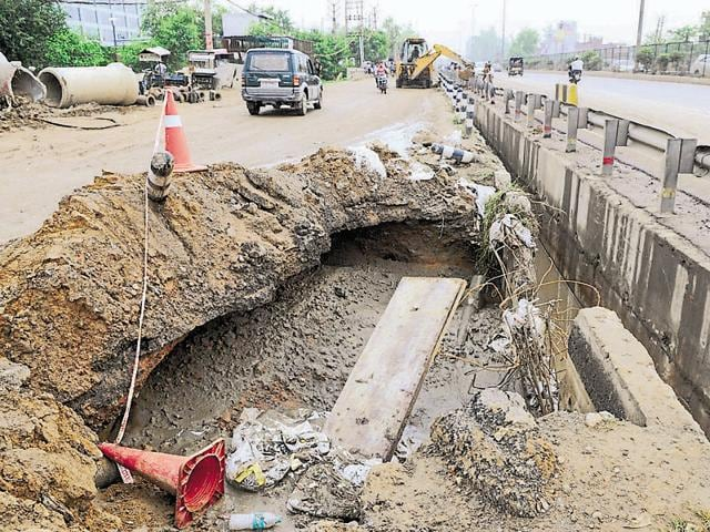 A cave-in on a Delhi-Gurgaon expressway service lane  on Saturday.