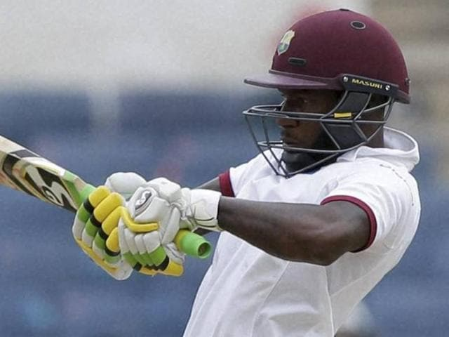 West Indies' Jermaine Blackwood plays a shot under the look of India's wicketkeeper Wriddhiman Saha.