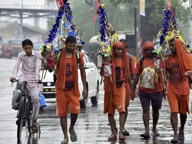 Kanwariyas on the street in New Delhi.