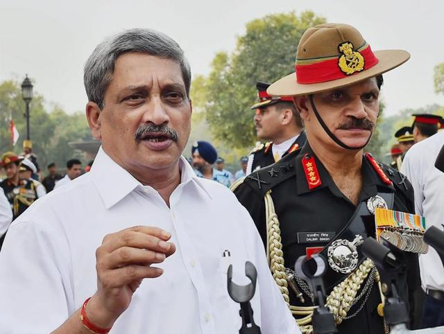 Defence minister Manohar Parrikar interacts with media after paying homage at Amar Jawan Jyoti on the occasion of Kargil Vijay Diwas in New Delhi.