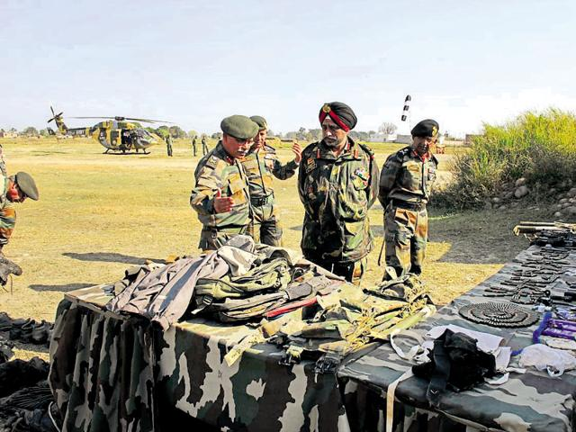Lt Gen KJ Singh inspecting weapons and equipment recovered after the Pathankot airbase attack. During his tenure, the effort of the troops was to check infiltration by terrorists as far forward as possible.