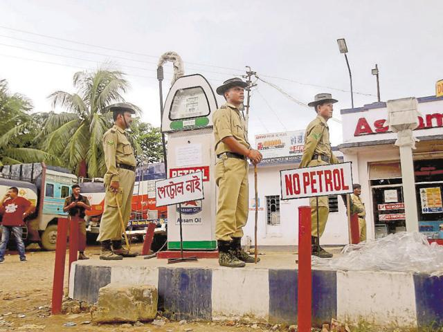 Policemen guard a fuel station during a protest against the petrol crisis in Agartala.