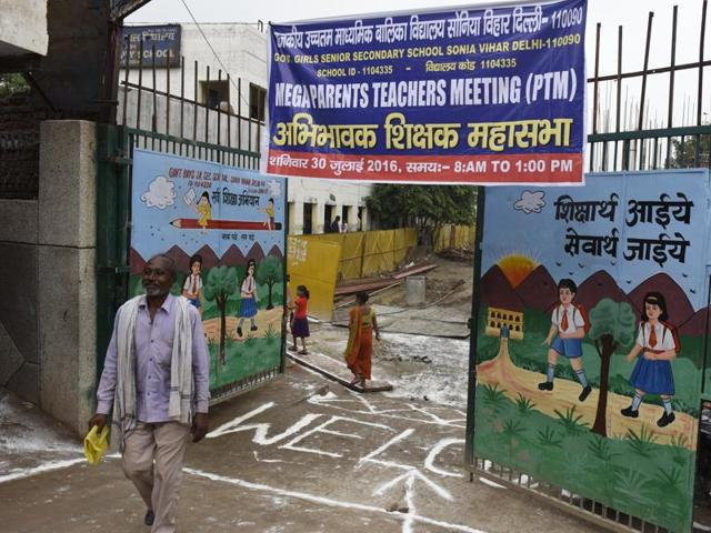 Students and parents coming out after the meeting during the Parents and Teachers Meet at a School in Sonia Vihar in New Delhi, India, on Saturday, July 30, 2016.