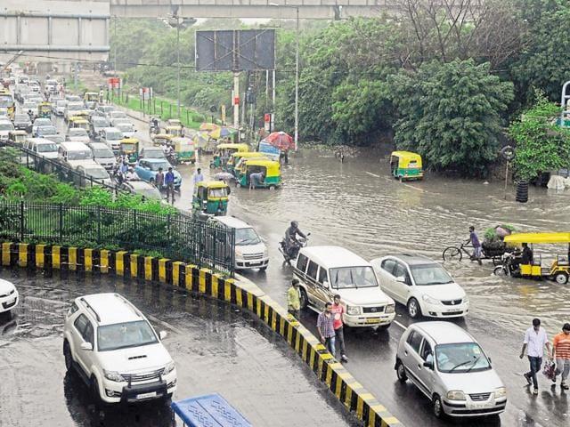 Waterlogging near the Botanic Garden bus station in Sector 37 of Noida on Saturday.
