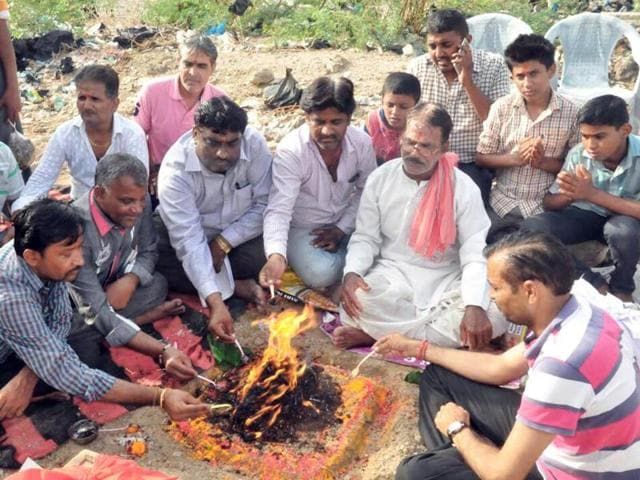 Barmer traders perform a special ritual in a crematorium to please the spirits late on Saturday evening.