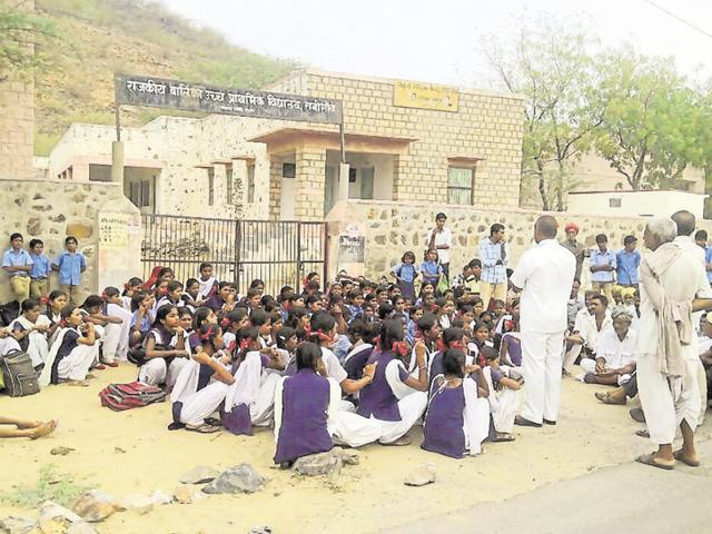 Girl students protest the proposed merger of their school with a boys' school, in Ranigaon on Monday.