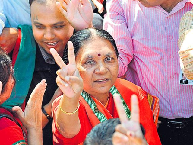 Gujarat chief minister Anandiben Patel flashes the victory sign during a BJP rally.