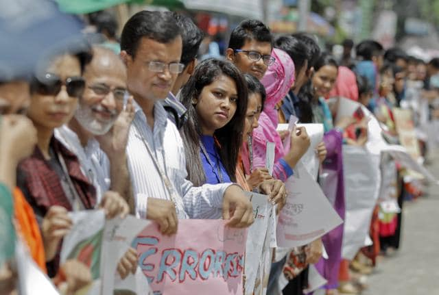 Bangladeshi students and teachers hold placards and form a human chain to protest against terrorism in Dhaka, Bangladesh, Monday, Aug. 1, 2016. The students from hundreds of colleges and universities in Dhaka and other cities took part in the protest Monday as part of a campaign to create awareness about the rise of Islamic extremism in the country. (AP Photo)