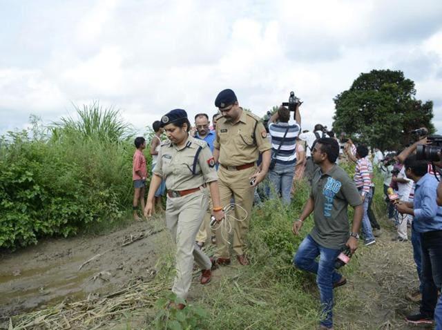 UP Police investigates the scene of crime on Sunday.(Sakib Ali/HT Photo)