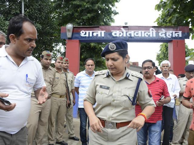 Police at the scene of crime in Dostpur village.