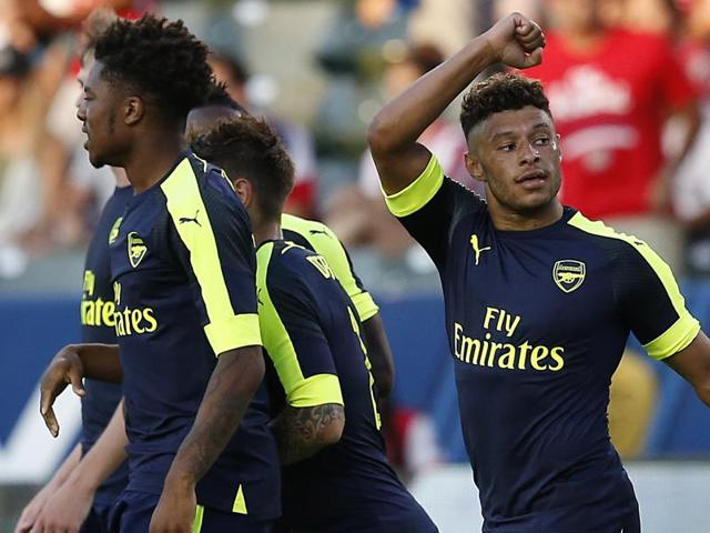 Arsenal's Alex Oxlade-Chamberlain (R) celebrates after scoring their second goal.