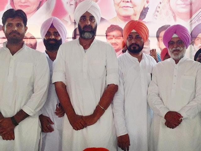 Congress leader Manpreet Singh Badal (third from left) during a rally at Chamkaur Sahib on Sunday.