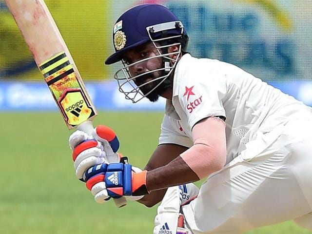 India's Lokesh Rahul celebrates after he scored a century against West Indies.