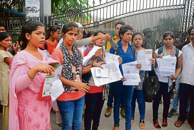 SSC aspirants protest with their admit cards after they were denied entry into their examination centre at Cambrian Public School.