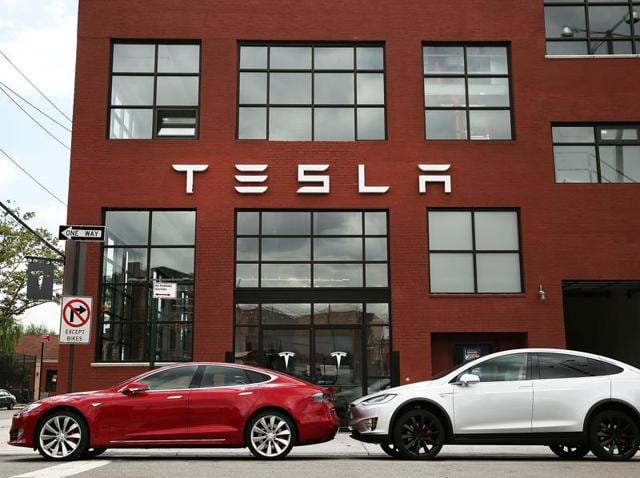 In this file photo, Tesla vehicles can be seen parked outside of a new company showroom and service centre in Red Hook.