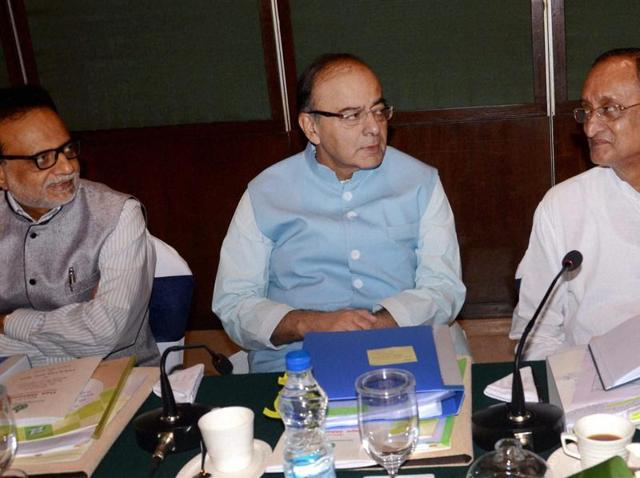 Union minister Arun Jaitley briefs the media with West Bengal finance minister Amit Mitra, and revenue secretary Hasmukh Adhia after a meeting of the Empowered Committee on GST, in Kolkata.