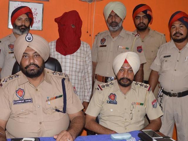 Murder accused Satnam Singh in police custody in Jalandhar.