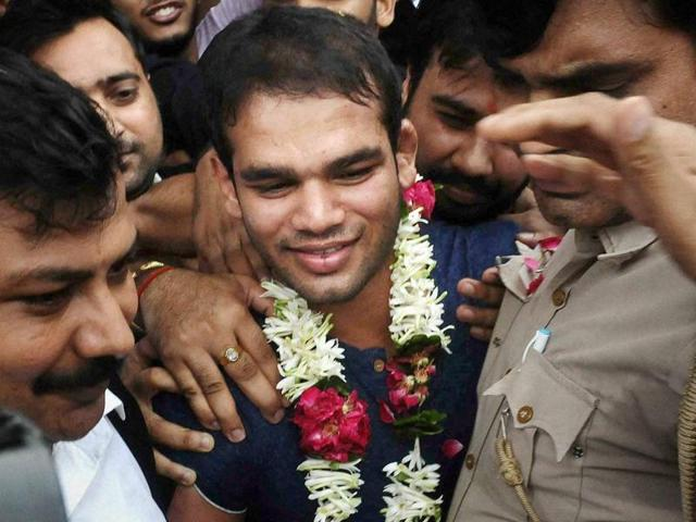 Wrestler Narsingh Yadav celebrates after NADA cleared him of doping charges.