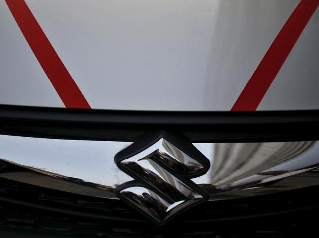 The logo of Maruti Suzuki India is seen on car parked outside a showroom in New Delhi.