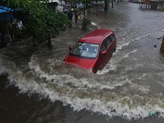 Heavy rainfall in Thane left main roads, including this one near Vandana Cinema, water-logged.
