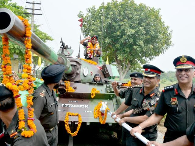 Officers and jawans of 63 Cavalry pulling a T-55 tank carrying retiring Western Army commander lieutenant general KJ Singh at Khasa Cantonment in Amritsar on Sunday. It was the first combat vehicle entrusted to him as a young second lieutenant in 1977.