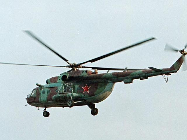 In this in this 2002 file photo, a Mi-8 helicopter flies over the Chechen regional capital Grozny, Russia. A helicopter similar to the one pictured has been shot down in Syria and Russian President Vladimir Putin's spokesman says all people aboard it have been killed.