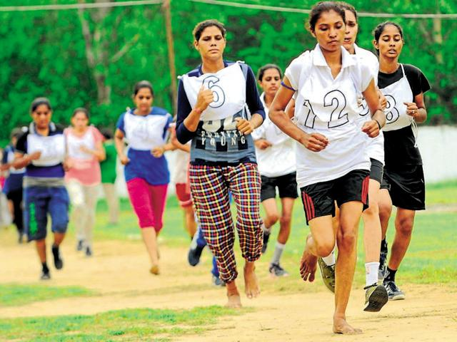Girls participating in the 800-metre race during the police recruitment drive in Patiala.