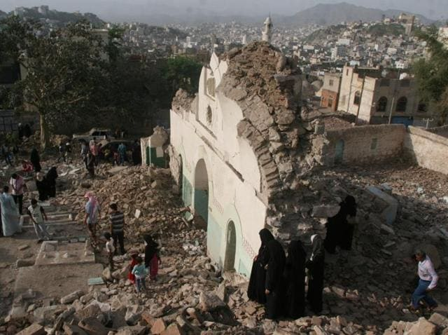 People gather among the rubble of a Sufi mosque that was blown up in an attack in Taez, Yemen on July 30, 2016. There were no casualties and no groups have claimed responsibility yet, according to local media.