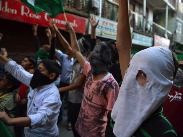 Masked Kashmiri protestors shout pro-freedom slogans during a protest in Srinagar.