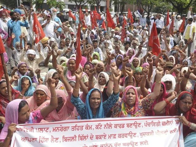 Members of labour and farmer unions during a protest outside the DC office in Jalandhar on Monday.