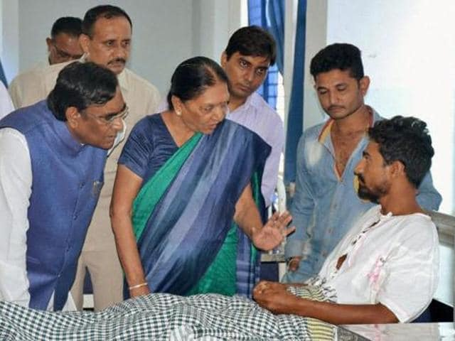 Anandiben Patel visits a dalit man who was assaulted by cow protectors recently, at a hospital in Rajkot district.