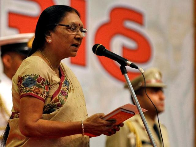 Anandiben Patel takes as the Gujarat chief minister during a swearing-in ceremony at Gandhinagar in Gujarat.