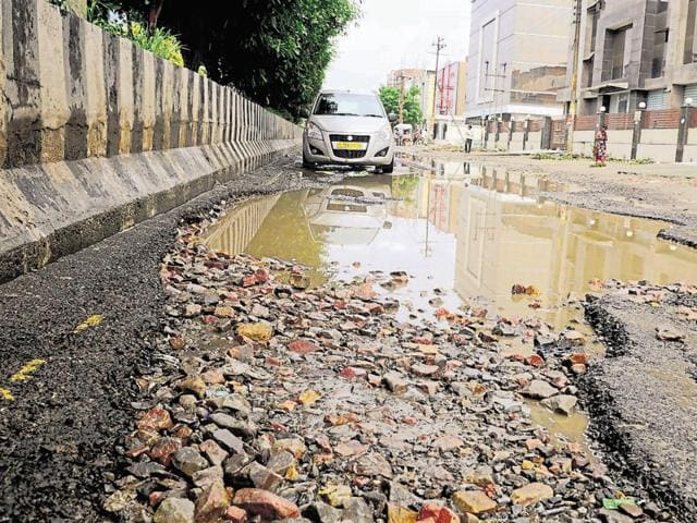 Even though the Noida authority claims to have repaired 200 potholes, stretches like the one above are still in a bad state.