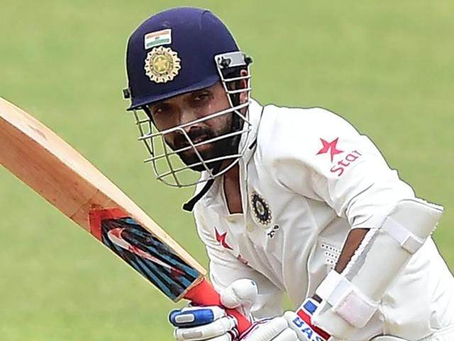 India's Ajinkya Rahane connects for a hit off West Indies bowler Miguel Cummins.