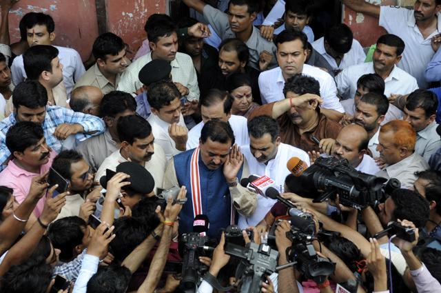 People surround the Bulandshahr gang rape victims' house Ghaziabad, August 2.