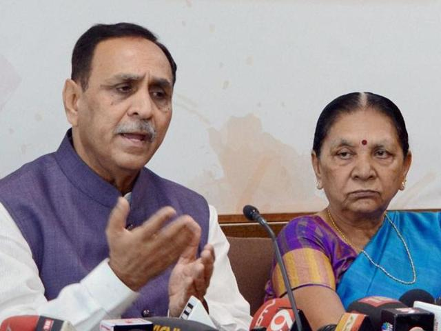 Vijay Rupani, an aide of BJP president Amit Shah, is seen as a fitting successor of the Gujarat CMAnandiben Patel (R)who offered to step down on Monday.